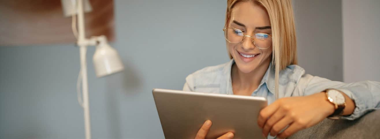 blonde woman reading tablet